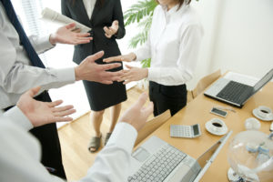 Business colleagues arguing in office